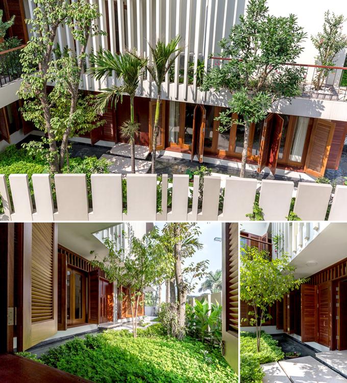 Cảnh quan sân vườn - Nhà phố lô góc 3 tầng 1 hầm mặt bằng chữ L hiện đại